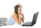 Teen girl on laptop with earphones isolated on white poster
