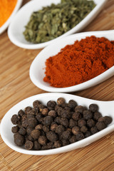 Assortment of spices with shadow in the background. Shallow DOF