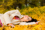 Fototapety Young pretty woman on the autumn leaf
