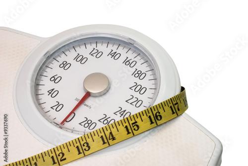 Leinwandbild Motiv Scales and tape measure isolated on white background.