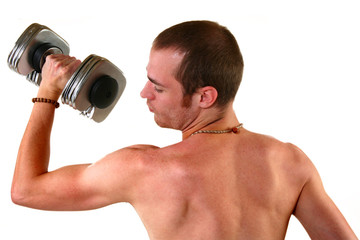 Attractive 20 Something man lifting weights.