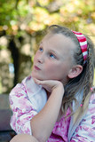 soft and dreamy focus image of a young girl wistful and waiting poster