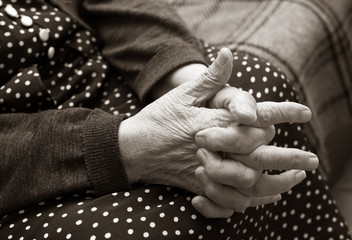 Hands of the elderly woman. B/w+sepia