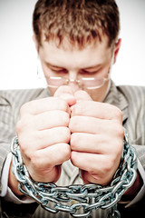 businessman with chain on hands, conceptual photography