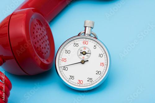 Leinwandbild Motiv Stop watch with telephone – very quick response time