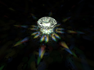 A sparkling brilliant cut diamond on dark background