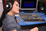 A young woman is listening to radio broadcasting