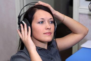 A young woman is listening to the music