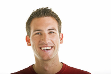 A young guy with a nice smile on a white background