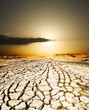 Leinwandbild Motiv sunset on the ground dried by dryness