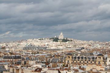 Roofs of Paris with Basilique du Sacre Coeur in background
