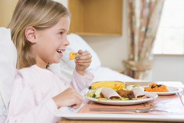 Young Girl Eating Hospital Food