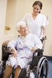 Nurse Pushing Woman In Wheelchair