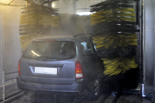 Rear view of vehicle being washed in automatic car wash