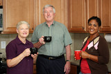 Happy Interracial Family Together In The Kitchen poster