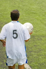 soccer player with number five on back