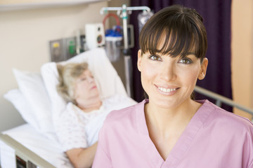 Nurse Standing In Hospital Room,Smiling