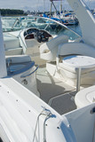 White motor boat in a Marina poster
