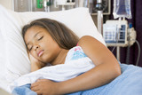 Young Girl Sleeping In Hospital Bed