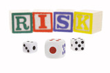 Gambling dice and letter blocks arranged to form the word