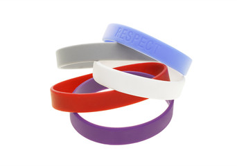 A stack of color wrist bands on white background