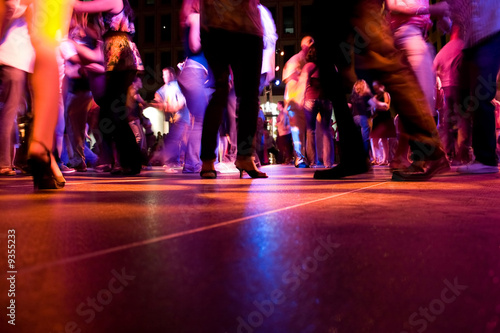 A low shot of the dance floor with people dancing - 9355233