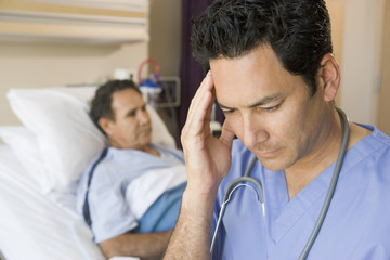 Doctor Looking Frustrated In Patients Room