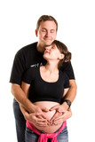 young pregnant woman and her husband embracing poster