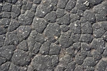 Very old asphalt - set of the cracks, damaged by weather.
