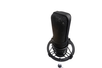 Black microphone isolated on white. Shot with wide lens.