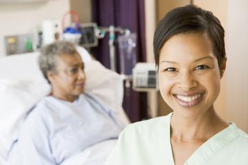 Nurse Standing In Patients Room