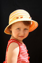 young girl in hat. Portret on a durk background