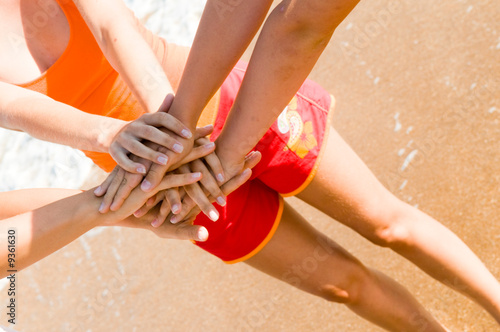 Hands against a beach