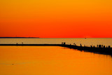 people enjoying summer sunset at pirita beach, estonia poster