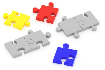 Colorful puzzle pieces isolated over a white background.