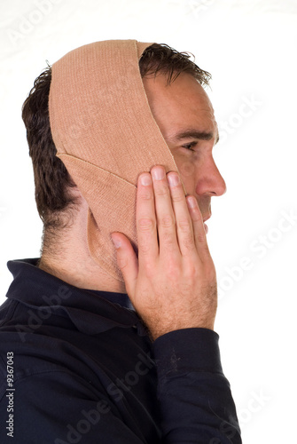 Profile view of a man weaing a bandage for his tooth pain