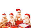 Group of adorable toddlers in Christmas hats