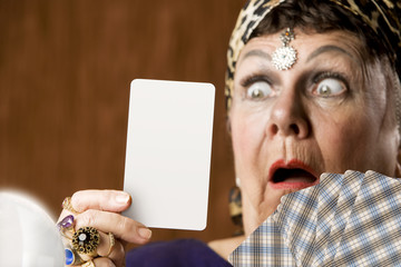 Gypsy fortune teller holding a blank tarot card