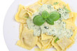Ravioli pasta with a spinach and cheese sauce
