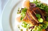 An image of a gourmet fish and citrus salad poster