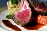 An image of gourmet lamb chops with garnishes poster