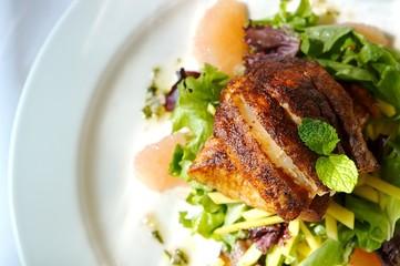 An image of a gourmet fish and citrus salad