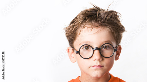 Face of cute guy in glasses isolated over white background