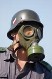 German soldier in gas mask . WW2 reenacting poster