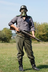 German soldier in gas mask . WW2 reenacting