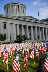 Columbus, Ohio statehouse with the lawn full flags