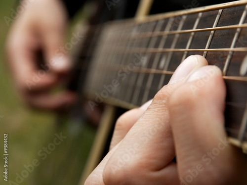 Fingers of a guitar player, shallow DoF
