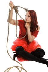 The beautiful girl in a red dress, thinks of suicide
