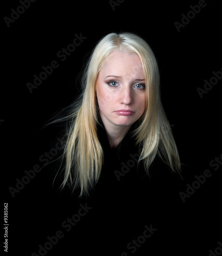 The melancholy girl on a black background. A series of photos