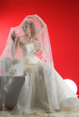 Young attractive woman in wedding dress